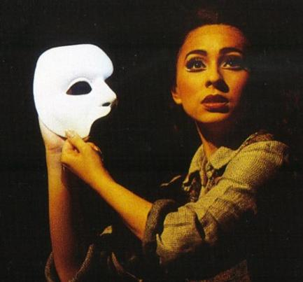 "Final scene, Meg holding the Phantom's abandoned mask. Meg was actually one of my favourite characters this time through: fascinating mix of ""concerned friend,"" ""I can't always deal with your s***, Christine,"" and ""Hey, I got stuff that *I* want to do too."" Photo Courtesy of: http://www.ruths-study.com/musicals/phantom/galleries/australia/ozpoto16.jpg"